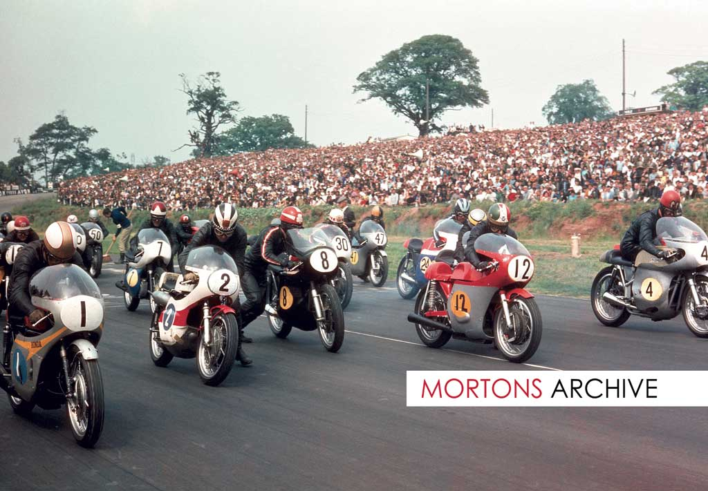 What a picture... taken at the Post TT in1968. Front row, from left Mike Hailwood (Honda), Phil Read (Yamaha), Rod Gould (Norton), Giacomo Agostini (MV) and John Cooper (Seeley). Also the star studded grid are 19 Pat Mahoney, 7 Percy Tait, 50 Percy May, 30 Barry Randle, 47 Brian Ball, 24 Rex Butcher and partially hidden behind 'Ago', Ray Pickrell.
