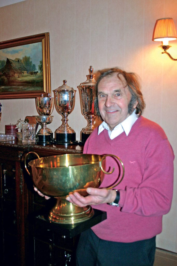 Percy Tait holding his trophy.