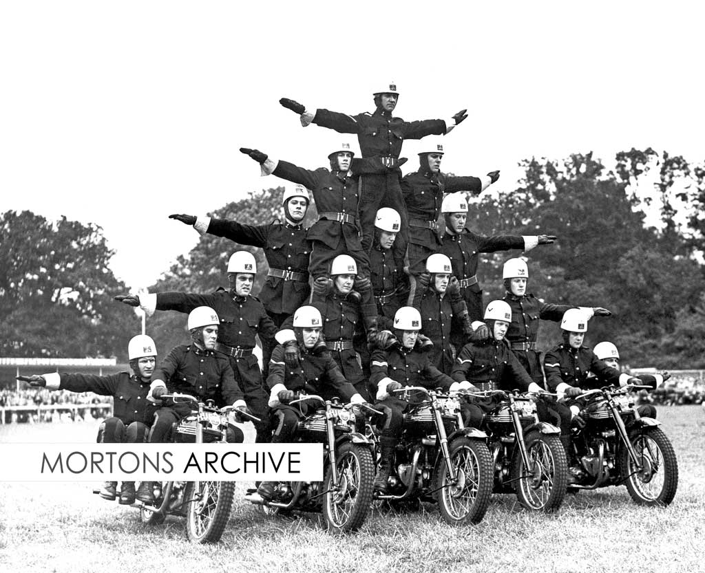 The White Helmets, the Royal Corps of Signals motorcycle display team, at Ravenham Park, London, in 1952. Motorcycles are Triumph 3Ts.